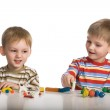 Boys mould toys from plasticine — Stock Photo #1744098