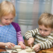 Small girl and boy help on kitchen — Stock Photo