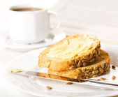 Breakfast of coffee and slices bread — Stock Photo