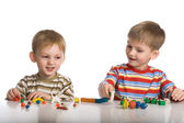 Boys mould toys from plasticine — Stock Photo