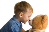 Little boy embraces a teddy — Stock Photo