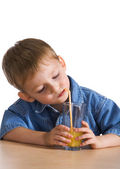 Child drinking orange juice — Stock Photo