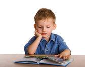 Criança com o livro — Fotografia Stock