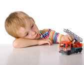 Tired boy with toys — Stock Photo