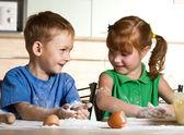 Little assistants on kitchen — Stock Photo