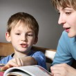 图库照片: Mother teach son to read