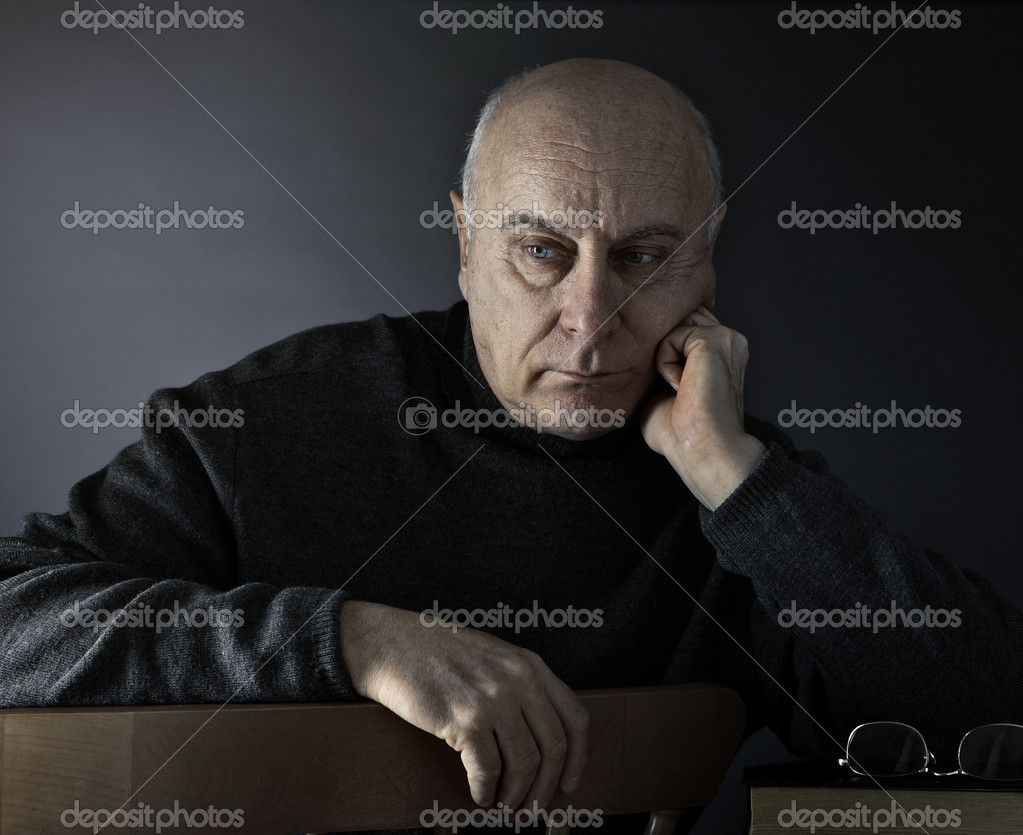 Senior man absorbed in thought  Stock Photo #1989770