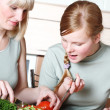 Stock Photo: Family preparation of meal