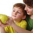 Mother gives son an apple — Stock Photo #2408805