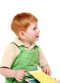 Redheaded kid with book — Stock Photo