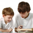 Brothers does lessons - Stock Photo