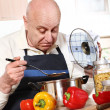 Mature man cooking — Stock Photo