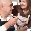 Senior couple preparing food — Stock Photo