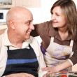 Stock Photo: Senior couple at kitchen preparing salad