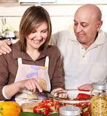 Senior smiling couple cooking at kitchen — Stock Photo
