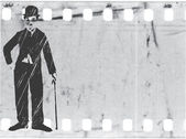 Vector silhouette chaplin on old film — Stockvektor