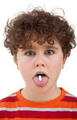 Boy with pill on his tongue — Stock Photo
