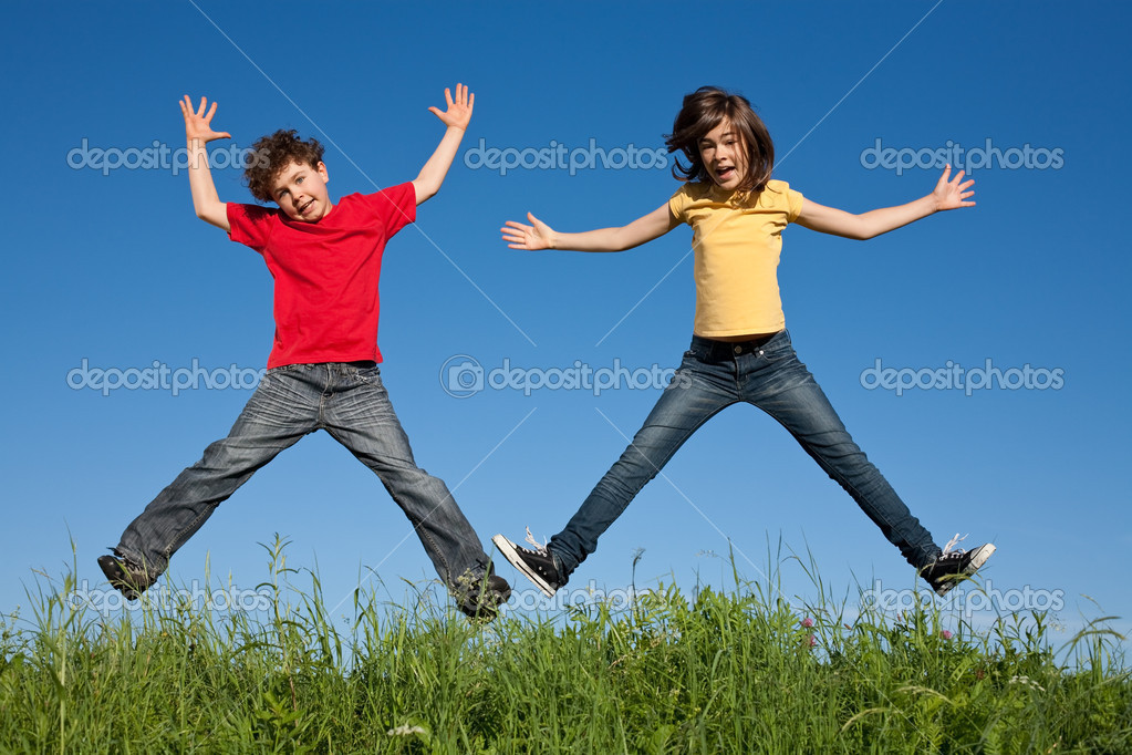 Kids jumping, running on green meadow  Stock Photo #1636338