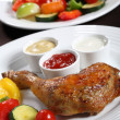 Stock Photo: Roasted chicken leg and vegetable