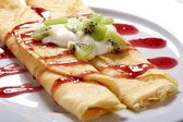 Pancakes with fruits — Stock Photo