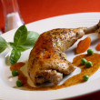 Stock Photo: Roasted chicken leg and vegetables
