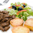 Grilled meat with fried potatoes — Stock Photo