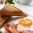 Breakfast - toasts, egg, bacon - Stock Photo