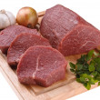 Raw beef on cutting board — Stock Photo