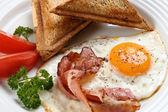 Breakfast - toasts, egg, bacon — Stock Photo