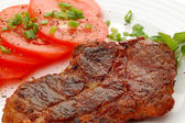 Grilled steak with vegetable salad — Stock Photo