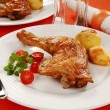 Stock Photo: Roasted chicken legs with vegetables