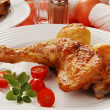 Stock Photo: Roasted chicken leg with vegetables