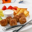 Roasted meatballs, fries and vegetables — Stock Photo #2167362