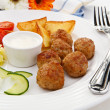 Roasted meatballs, fries and vegetables — Stock Photo #2167374