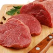 Raw beef on cutting board isolated — Stock Photo #2501904