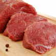 Raw beef on cutting board isolated — Stock Photo #2501907