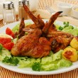 Stock Photo: Roasted chicken wings with vegetables