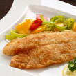 Fried fish fillet with vegetables — Stock Photo