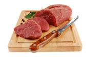 Raw beef on cutting board isolated — Stock Photo