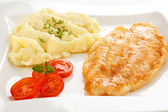 Fried fish fillet with boiled potatoes — Stockfoto