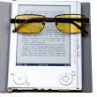 Stock Photo: E-book with glasses isolated on white