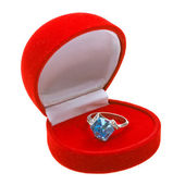 Silver ring with topaz in red box — Stock Photo