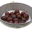 Sweet cherry in a plate on white — Stok fotoğraf