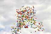 Colored balloons on sky to background — Stock Photo