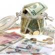 Different money in the glass jar — Stock Photo