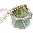 Money in the glass jar on white — Stock Photo