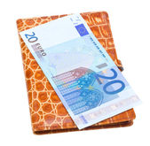 Wallet filled with money on white — Stock Photo