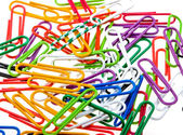 Color paper clips to background — Stock Photo