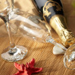 Champagne sparkling on a beach — Stock Photo #1655784