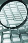 Magnifying glass, button, key — Stock Photo